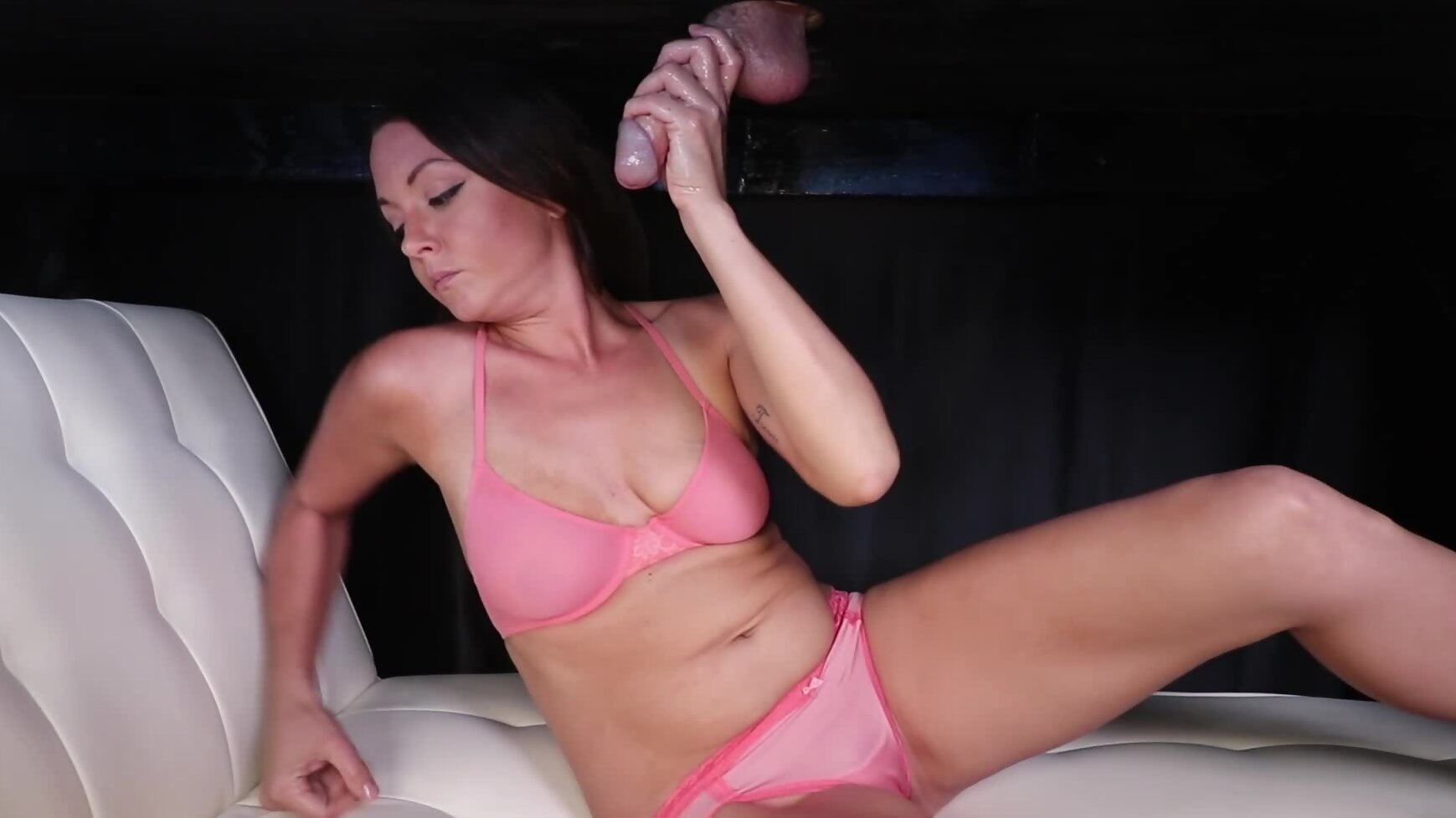 Splendid masseuse in pink lingerie milks cock under the t...