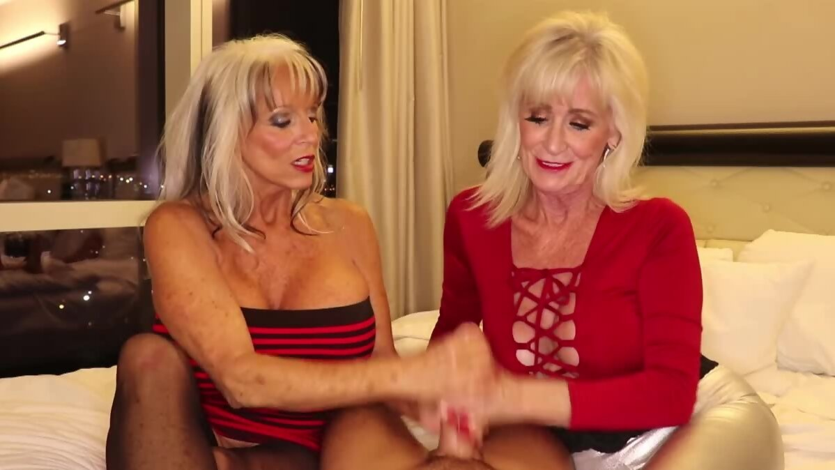 Two busty grannies skillfully stroke big dick and talk dirty